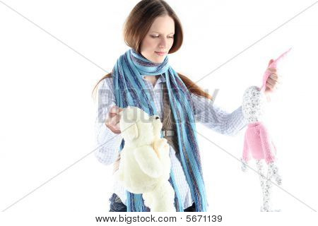 Young Girl With Rabbit Toy And Teddy Bear