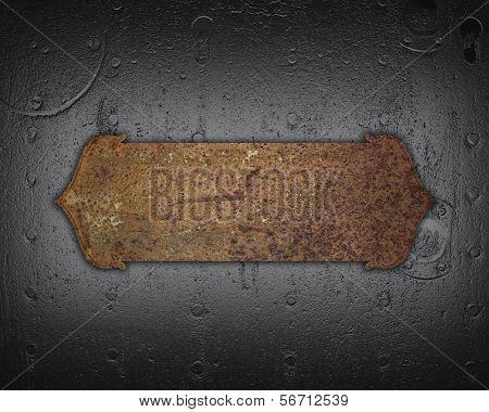 Iron wall with studs and rusty sign. design template