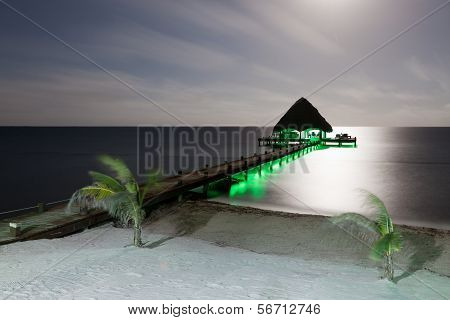 Beach And Dock With Lights