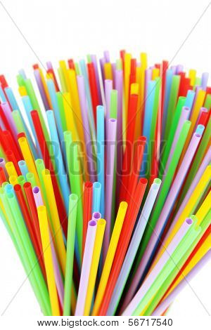 Many straws close-up isolated on white