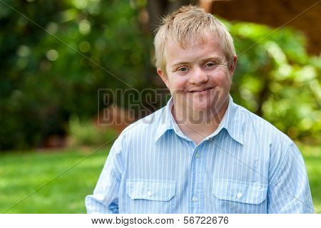 Smiling Handicapped Boy Outdoors.