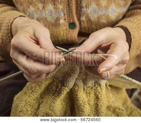 Hands Of An Older Woman Knitting