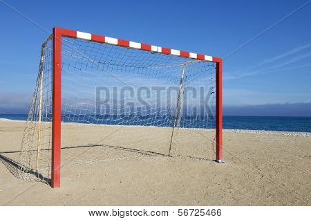 red and white goal with blue sky