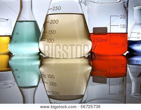 several glassware with color liquid