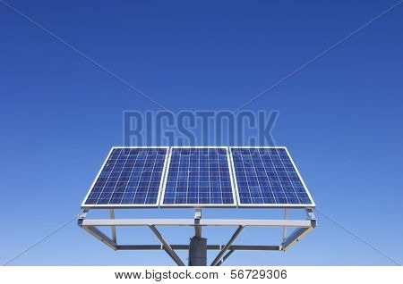 small photovoltaic panel against a clear blue sky