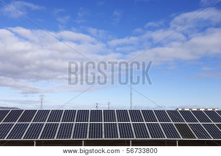 solar panels for power production with beautiful sky