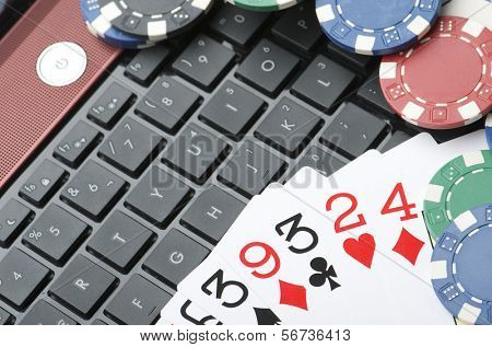 view of casino chips and cards to gamble and play online
