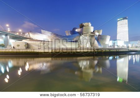 BILBAO, SPAIN - JULY 30: Guggenheim Museum and Iberdrola Tower on July 30, 2011 in Bilbao. Guggenheim Museum is dedicated  exhibition of modern art and was  designed by architect Frank Gehry.