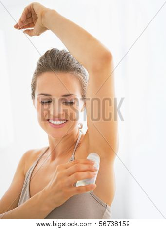 Happy Young Woman Deodorant On Underarm