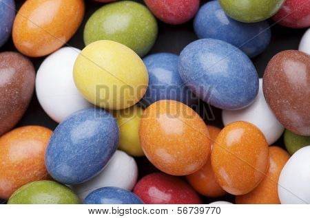 group of chocolate and caramel candies of various colors