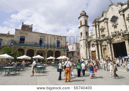 HAVANA, CUBA  - JANUARY 29: Square on January 29, 2007: street scene in the cathedral square, stands the Cathedral of San Cristobal. This is a typical place frequented by visiting tourists.