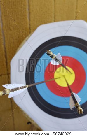 three arrows in the center of a dartboard