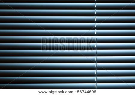 Closed Venetian Blinds Under Night Light