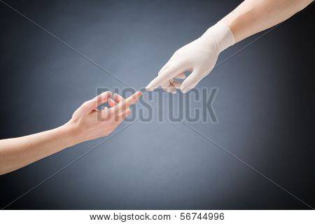 Doctor And Patient Touching Hands