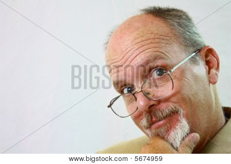 Happy Man With Glasses on his nose.