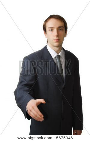 Young Business Man Approaching For A Hand Shake