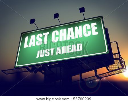 Last Chance Just Ahead on Green Billboard.