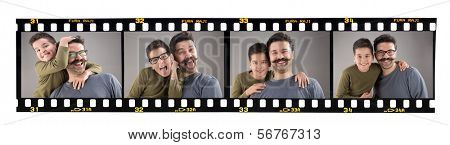 Happy father and son images on old fashioned 35mm filmstrip isolated on white background. Brand name Fura Raji is not real, created by myself.