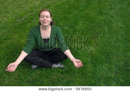 Woman Meditate On Field
