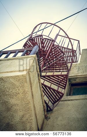 Red Metal Spiral Stair Shoot From A Worm's Eye View