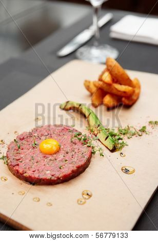 Beef tartare on restaurant table, lots of copy space