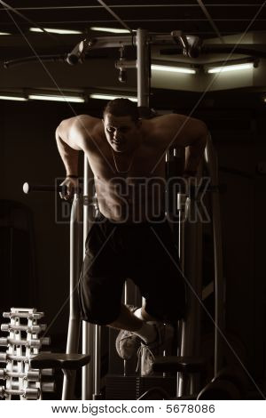 Guy Training In Gym