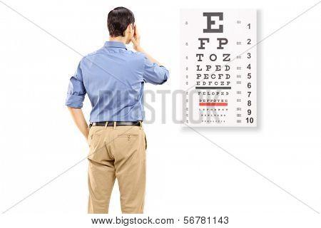 Portrait of a man taking eyesight test, isolated on white background
