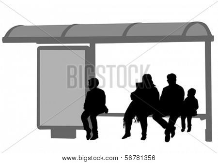 Silhouettes of people at bus stop