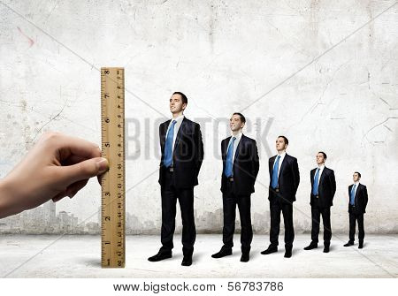 Successful confident businessmen standing in line. Progress in career