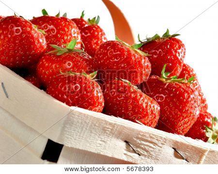 Basket Of Juicy Strawberries On White Studio Background