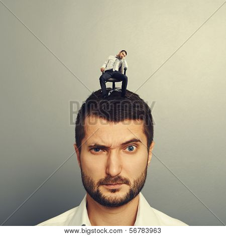 portrait of amazed man with bored man on the head