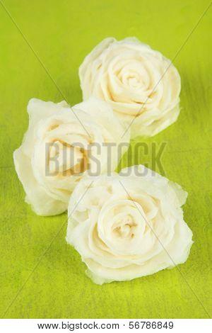 Sugar roses, on color background