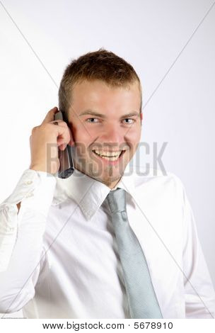 Cheerful Young Man On The Phone