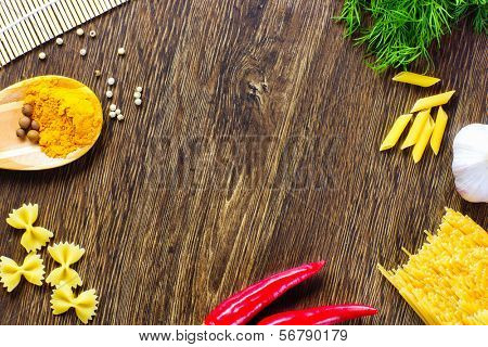 Chilli pepper macaroni herbs and splices on kitchen table