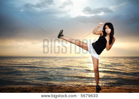 Karate Girl On The Beach