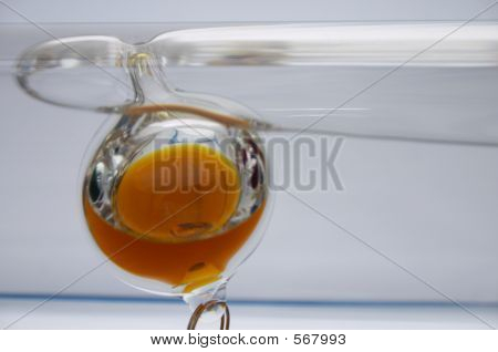 Close-up Of An Galileo Thermometer, Yelow Liquid