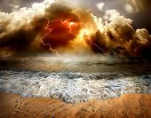 picture of thunder-storm  - Storm clouds and lightning over the sea - JPG