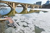 Washington DC - Francis Scott Key Bridge over frozen Potomac River in Winter season