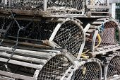 picture of lobster trap  - Old Stacked wooden lobster traps on pier - JPG
