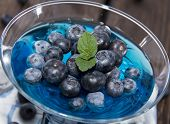 foto of jello  - Fresh made Blueberry Jello on wooden background - JPG