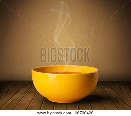 Fresh delicious home cooked soup with steam on wood deck