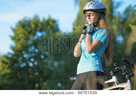 Female Cycling Athlet In Professional Cycling Gear Outdoor. Horizontal Image