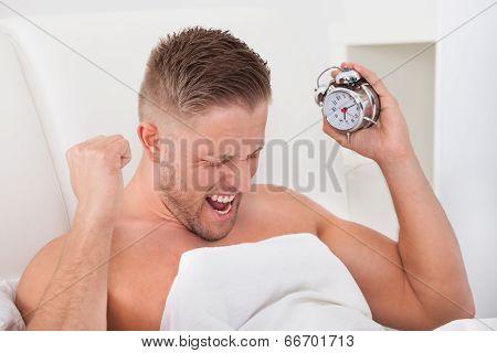 Man Screaming In Frustration At His Alarm Clock