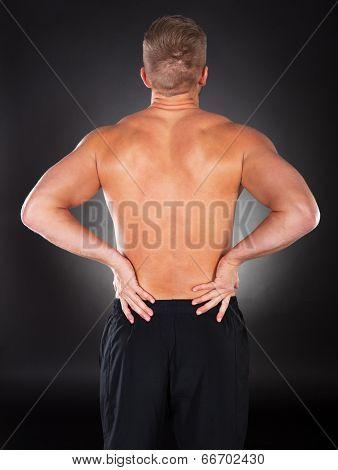 Strong Muscular Man With Backache