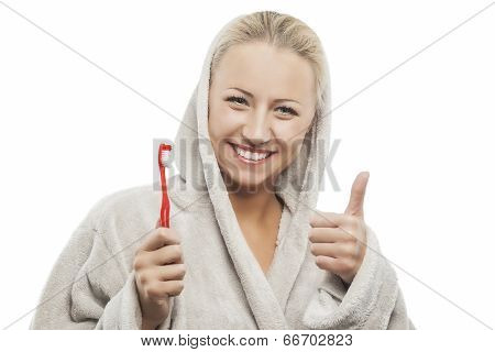 Positive Young Blond Woman With Manual Toothbrush Showing Thumbs Up Sign
