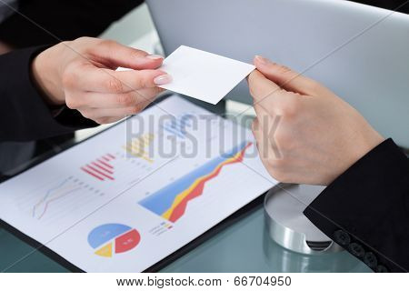 Businesswomen Exchanging Business Card
