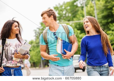 Group of multi ethnic students walking in a city