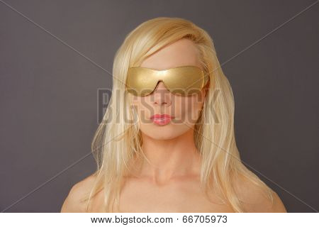 Front view of a Blonde Woman with Gold Glasses.