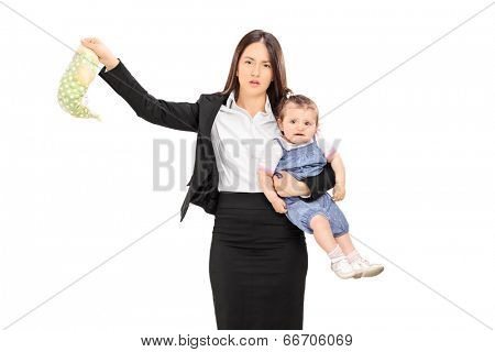 Young mother holding her baby and a stinky diaper isolated on white background