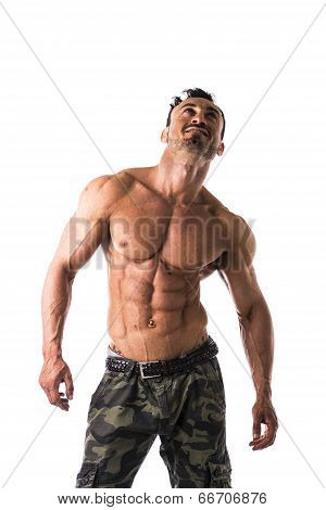 Frontal Shot Of Shirtless Muscular Young Man In Military Pants